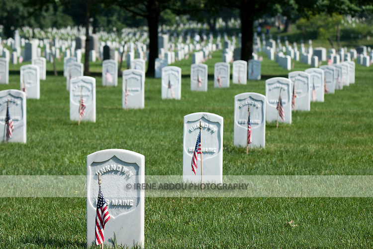An American flag lines each gravestone in remembrance of unknown soldiers on Memorial Day in Arlington National Cemetery, Virginia.