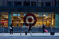 NEW YORK, NEW YORK - MARCH 02: People walk in the street next to Target store on March 02, 2021 in New York. Target hopes to build a growth by investing about $ 4 billion annually for the next years to accelerate the consolidation of new stores, upgrade existing ones and enhance its capacity to fulfill online orders. (Photo by Emaz/VIEWpress)