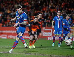 Greg Tansey scores from the penalty spot to put Inverness ahead