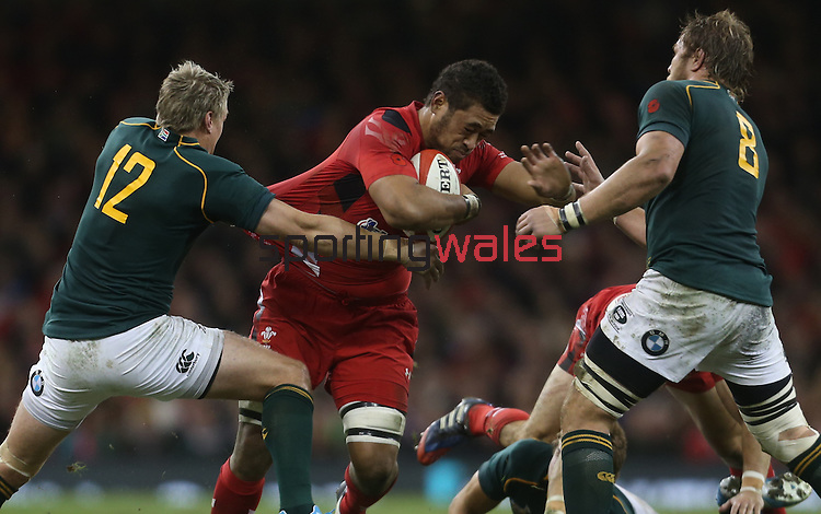 Wales number 8 Toby Faletau runs into trouble as Springbok pair Jean De Villiers and Duane Vermeulen close in.<br /> <br /> 2013 Dove Men Series<br /> Wales v South Africa<br /> Millennium Stadium<br /> 09.11.13<br /> ©Steve Pope-Sportingwales