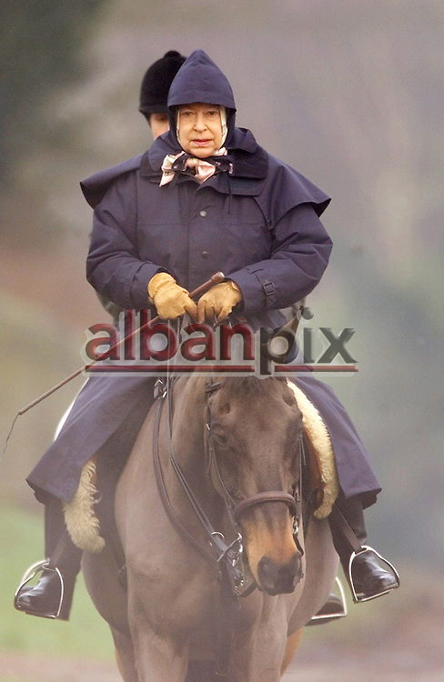 Copyright   Albanpix.com-Picture by Alban Donohoe.The Queen out riding on the Sandringham estate today 9-01-01.