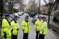 Massachusetts State Police stand guard as media and crowds gather on Franklin Street in Watertown, Mass., near the scene of the capture of Boston Marathon Bombing suspect #2 Dzhokhar Tsarnaev, on April 20, 2013.  Tsarnaev was captured the day before just a block away in a residential area of Watertown after a day-long search that shut down the metropolitan Boston area.
