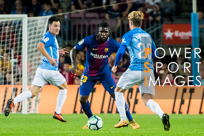 Samuel Umtiti (c) of FC Barcelona fights for the ball with Sergio Gontan Gallardo, Keko, of Malaga CF during the La Liga 2017-18 match between FC Barcelona and Malaga CF at Camp Nou on 21 October 2017 in Barcelona, Spain. Photo by Vicens Gimenez / Power Sport Images