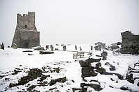 UK Weather: Heavy flurries of snow blanket Aberystwyth castle, west Wales,  on a cold February morning in Aberystwyth, west Wales, UK. Tuesday 06 February 2018. <br /> The Met Office has issued a 'yellow' warning for snow and ice, as a band of sleet and snow moves in from the west, to cover much of Wales and the north of England