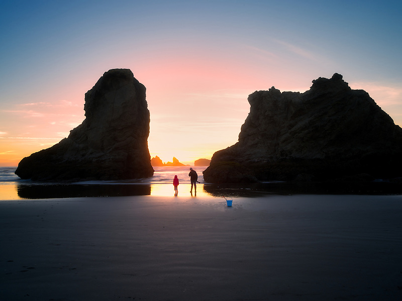 Father and daughter at beach with sunset. Bandon, Oregon