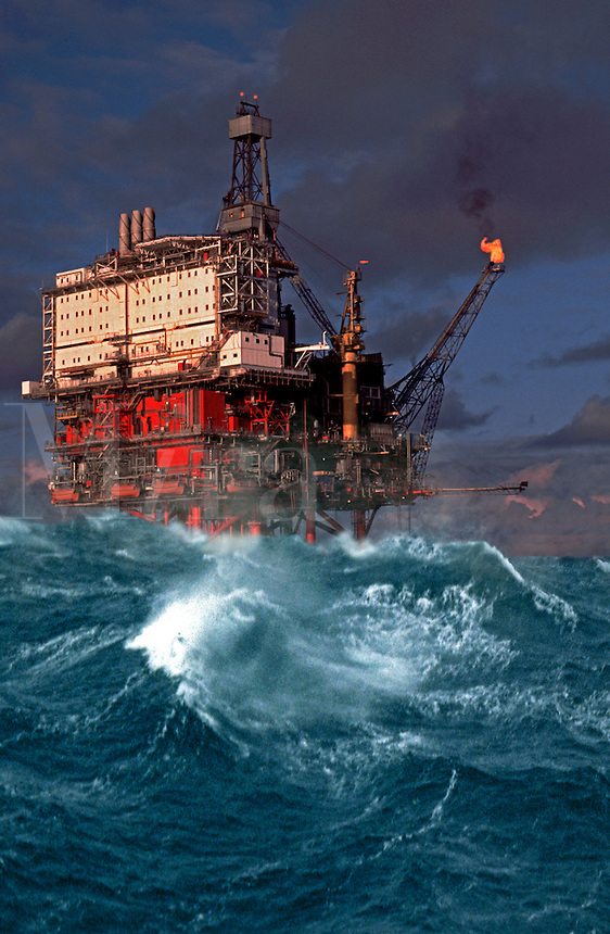 Oil production platform, stormy weather, rough sea. North Sea. Digital composite,