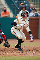 Aaron Shackelford (44) of the Greensboro Grasshoppers follows through on his swing against the Rome Braves at First National Bank Field on May 16, 2021 in Greensboro, North Carolina. (Brian Westerholt/Four Seam Images)
