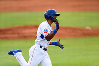 Tennessee Smokies center fielder Brennen Davis (21) hustles to first base against the Chattanooga Lookouts at Smokies Stadium on June 18, 2021, in Kodak, Tennessee. (Danny Parker/Four Seam Images)