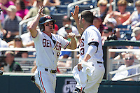 Oregon State Beavers outfielder Max Gordon #4 celebrates with catcher Jake Rodriguez #13 after scoring a run during Game 5 of the 2013 Men's College World Series between the Oregon State Beavers and Louisville Cardinals at TD Ameritrade Park on June 17, 2013 in Omaha, Nebraska. The Beavers defeated the Cardinals 11-4. (Brace Hemmelgarn/Four Seam Images)