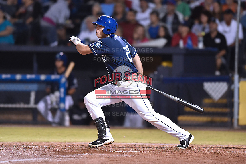 Asheville Tourists first baseman Roberto Ramos (27) swings at a pitch during game 3 of the South Atlantic League Championship Series between the Asheville Tourists and the Hickory Crawdads on September 17, 2015 in Asheville, North Carolina. The Crawdads defeated the Tourists 5-1 to win the championship. (Tony Farlow/Four Seam Images)