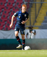 GUADALAJARA, MEXICO - MARCH 18: Justen Glad #4 of the United States moves with the ball during a game between Costa Rica and USMNT U-23 at Estadio Jalisco on March 18, 2021 in Guadalajara, Mexico.