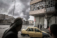 In this Thursday, Oct. 25, 2012 photo. Smoke rises from the battlefield in Karmal Jabl neighborhood, during clashes between rebel fighters and the Syrian army in Aleppo City. (AP Photo/Narciso Contreras).