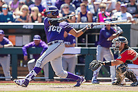 TCU Horned Frogs first baseman Michael Landestoy (13) follows through on his swing against the Texas Tech Red Raiders in Game 3 of the NCAA College World Series on June 19, 2016 at TD Ameritrade Park in Omaha, Nebraska. TCU defeated Texas Tech 5-3. (Andrew Woolley/Four Seam Images)