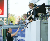 Hannah Eurlings (9) of OHL gives a hand to young support before a female soccer game between Oud Heverlee Leuven and Standard Femina de Liege on the third matchday of the 2021 - 2022 season of Belgian Womens Super League , Sunday 5 th of September 2021  in Leuven , Belgium . PHOTO SPORTPIX.BE   SEVIL OKTEM