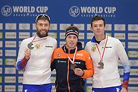 SPEEDSKATING: 09-12-2018, Tomaszów Mazowiecki (POL), ISU World Cup Arena Lodowa, Podium 10.000m Men Division A, Alexander Rumyantsev (RUS), Marcel Bosker (NED), Danila Semerikov (RUS), ©photo Martin de Jong