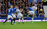 Liverpool, UK. Saturday 01 November 2014<br /> Pictured: Jonjo Shelvey of Swansea (R) clashes against Leighton Baines of Everton.<br /> Re: Premier League Everton v Swansea City FC at Goodison Park, Liverpool, Merseyside, UK.