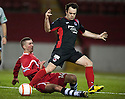 Clyde's Sean Fitzharris (black) is challenged by Shire's Michael Hunter (red).