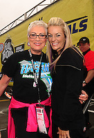 Jul. 31, 2011; Sonoma, CA, USA; NHRA top fuel dragster legend Shirley Muldowney (left) poses for a picture with pro stock motorcycle rider Angie Smith during the Fram Autolite Nationals at Infineon Raceway. Mandatory Credit: Mark J. Rebilas-