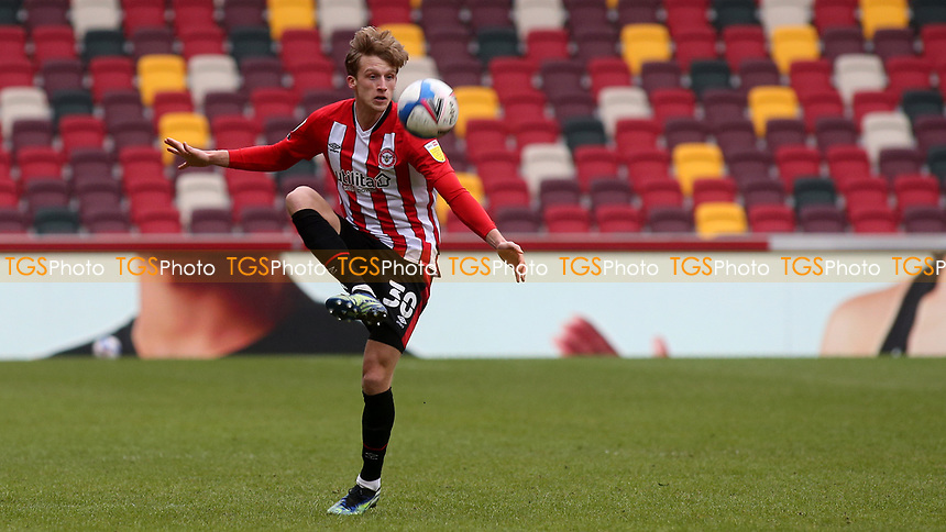 Mads Roerslev of Brentford in action during Brentford vs Barnsley, Sky Bet EFL Championship Football at the Brentford Community Stadium on 14th February 2021