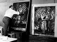 Albert Sterner painting war posters for the Government,  Ca.  1918. IFS. (War Dept.)<br /> Exact Date Shot Unknown<br /> NARA FILE #:  165-WW-61-8<br /> WAR & CONFLICT BOOK #:  518