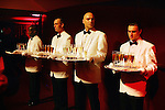 NEW YORK -- DECEMBER 15, 2005:  Waiters hold trays of champagne at the Young Art Collectors annual holdiay party at the Guggenheim Museum on December 15, 2005 in New York City.  (PHOTOGRAPH BY MICHAEL NAGLE)