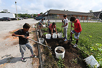 Kaiden Stitt, 9, (from the left) Betty Metcalf, Eli Eagle, 9, Angelina Virto, 12, Aiden Cullens, 12 and Jaylen Jones, 11 make garden beds during the Lifesource Summer Program Monday July 19, 2021. The project is spearheaded by program director Betty Metcalf. Metcalf also teaches at Butterfield Elementary School in Fayetteville and manages a garden project there. Visit nwaonline.com/21000720Daily/ and nwadg.com/photo. (NWA Democrat-Gazette/J.T. Wampler)