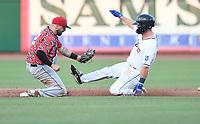 Northwest Arkansas Naturals' Brewer Hicklen gets caught at second base by Arkansas Travelers's Jordan Cowan Tuesday July 13, 2021 at Arvest Ballpark in Springdale. Visit nwaonline.com/21000714Daily/ and nwadg.com/photo. (NWA Democrat-Gazette/J.T. Wampler)