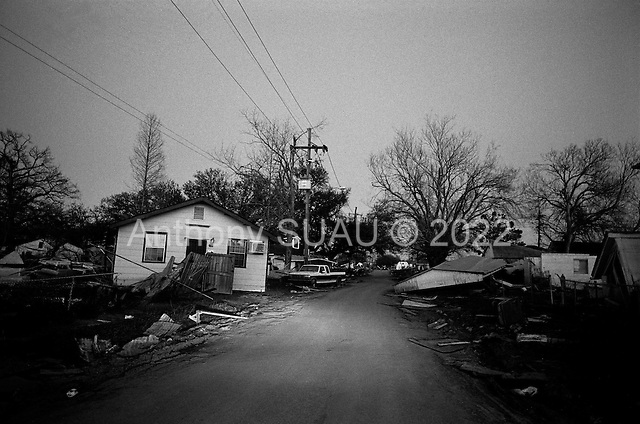 New Orleans, Louisiana.USA.February 28, 2006..Sunset in the lower ninth ward as Mardi Gras and Fat Tuesday come to and end. It was  poor area completely destroyed when the levees broke flooding the area after hurricane Katrina.