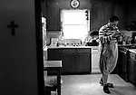 """Kevin Ross, aka Irvin D. Clown, prepares his costume at home for a Christian ministry tour in Durham. Clowning around in the name of Christ has been his full-time job for the past 10 years. 'God is a joyful God. He wants us to have fun,"""" said Ross."""