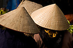 Vietnamese women wearing conical non hats, Nguyen Thien Thuat St, Hanoi Old Quarter, Viet Nam