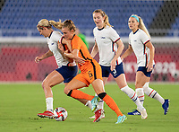 YOKOHAMA, JAPAN - JULY 30: Lindsey Horan #9 of the USWNT fights for the ball with Jill Roord #6 of the Netherlands during a game between Netherlands and USWNT at International Stadium Yokohama on July 30, 2021 in Yokohama, Japan.