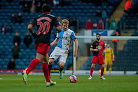 BLACKBURN, ENGLAND - JANUARY 24:  Chris Taylor of Blackburn Rovers  takes the ball past Jefferson Montero of Swansea City during the FA Cup Fourth Round match between Blackburn Rovers and Swansea City at Ewood park on January 24, 2015 in Blackburn, England.  (Photo by Athena Pictures/Getty Images)