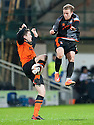Dundee Utd's Paul Paton and Killie's Ross Barbour go in high.