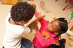 Education Preschool 3-4 year olds argument struggle betwen boy and girl