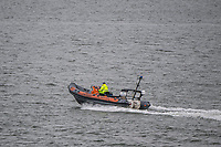 BNPS.co.uk (01202 558833)<br /> Pic: MaxWillcock/BNPS<br /> Date taken: 27/06/2021<br /> <br /> Pictured: A harbour patrol boat searching the water.<br /> <br /> A body has today been found in the search for a heroic teenager who is feared to have drowned after rescuing his nieces and nephews from a ferocious riptide.<br /> <br /> Callum Osborne-Ward, 18, was swept away in front of his family moments after lifting the last of a group of about 13 children into a rescue boat.<br /> <br /> The youngsters had been swimming and playing in relatively shallow water close to Black Bridge at Rockley Point in Poole Harbour, Dorset, when they were dragged away by the fast flowing tide at about 4pm on Monday.