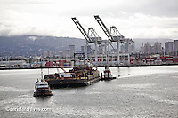 aerial photograph tugs pulling and pushing barge Port of Oakland, California