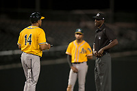 AZL Athletics manager Eddie Menchaca (14) questions a call by field umpire Demetrius Hicks during an Arizona League game against the AZL Cubs 1 at Sloan Park on June 28, 2018 in Mesa, Arizona. The AZL Athletics defeated the AZL Cubs 1 5-4. (Zachary Lucy/Four Seam Images)