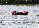 Tommy Thompson, driver of the Tommy Thompson Pro Modified Drag boat suffering a nasty wreck  and getting pulled from the water at the Marble Falls Lakefest Drag Boat Races.