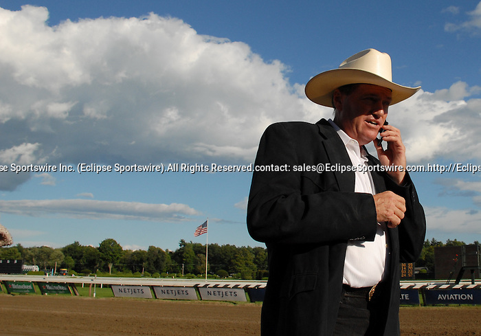 16 August 2008: Trainer Larry Jones calls his wife, Cindy, on the phone after Proud Spell won The Alabama at Saratoga Race Course in Saratoga Springs, New York.  Cindy Jones was in Oceanport, New Jersey at Monmouth Park handling Honest Man for his upset win in the Iselin Handicap.