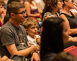 """July 26, 2017. Raleigh, North Carolina.<br /> <br /> Jonas Hutchinson, age 8, listens to Alan Gratz discuss his new book """"Refugee"""".<br /> <br /> Author Alan Gratz spoke about and signed his new book """"Refugee"""" at Quail Ridge Books. The young adult fiction novel contrasts the stories of three refugees from different time periods, a Jewish boy in 1930's Germany , a Cuban girl in 1994 and a Syrian boy in 2015."""