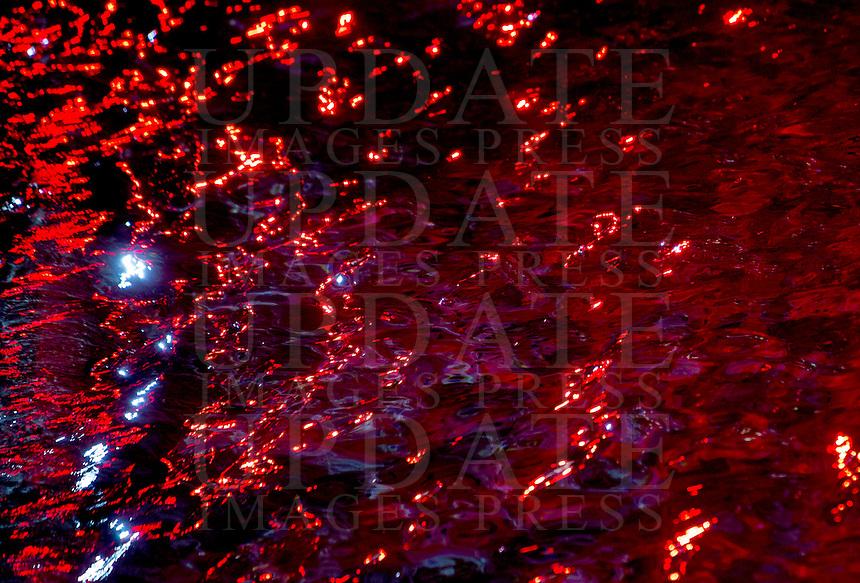 La Fontana di Trevi illuminata di rosso durante un evento per ricordare i martiri cristiani nel mondo, a Roma, 29 aprile 2016.<br /> The Trevi Fountain is illuminated in red to symbolize blood during an event in memory of Christian martyrs around the world, in Rome, 29 April 2016.<br /> UPDATE IMAGES PRESS/Riccardo De Luca