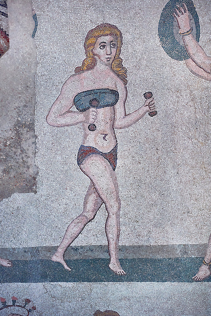 Close up picture of the Roman mosaics of the room of the Ten Bikini Girls depicting Roman women in an athletic competition, room no 30, at the Villa Romana del Casale, first quarter of the 4th century AD. Sicily, Italy. A UNESCO World Heritage Site.