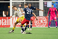FOXBOROUGH, MA - MAY 16: Amor Traustason #25 of New England Revolution comes in to tackle Pedro Santos #7 Columbus SC during a game between Columbus SC and New England Revolution at Gillette Stadium on May 16, 2021 in Foxborough, Massachusetts.