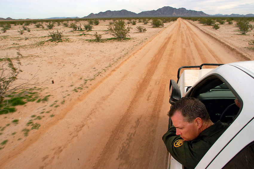 A Yuma County Border Patrol agent  (who wished to not give out his name) combs the deserts of Yuma County Arizona, one of the busiest immigrant corridors in the country. He looks for signs on the sand, as border-crossers attach foam boards on their shoes, to avoid making prints in the sand. .Yuma County, Arizona. 01/14/08.                .