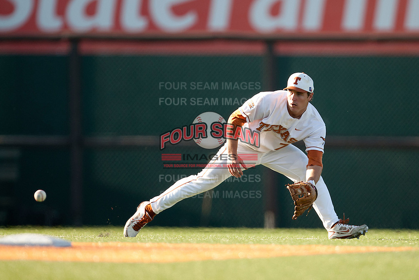 Texas Longhorns  shortstop Jordan Etier #7 fields a ground ball during the NCAA baseball game against the Central Arkansas Bears on April 24, 2012 at the UFCU Disch-Falk Field in Austin, Texas. The Longhorns beat the Bears 4-2. (Andrew Woolley / Four Seam Images).