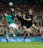 Saturday 17th November 2018 | Ireland vs New Zealand<br /> <br /> Keith Earls, Beauden Barrett and Jack Goodhue challenge for this high ball during 2018 Guinness Series between Ireland and Argentina at the Aviva Stadium, Lansdowne Road, Dublin, Ireland. Photo by John Dickson / DICKSONDIGITAL
