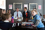 © Joel Goodman - 07973 332324 . 11/04/2015 . Bury , UK . Labour Shadow Chancellor Ed Balls and James Frith , Labour candidate for Bury North , at a campaign stop at Barista coffee shop at The Rock , Bury in Greater Manchester , UK . The pair met parents and discussed family finances . Photo credit : Joel Goodman