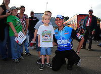 Mar. 10, 2012; Gainesville, FL, USA; NHRA top fuel dragster driver T.J. Zizzo signs autographs for fans during qualifying for the Gatornationals at Auto Plus Raceway at Gainesville. Mandatory Credit: Mark J. Rebilas-