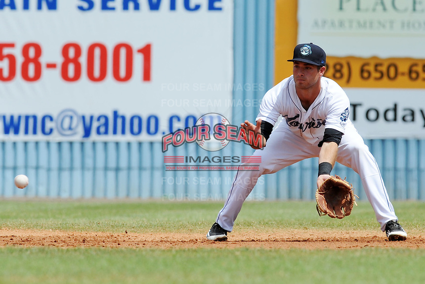 Asheville Tourists  shortstop Taylor Featherston #2  fields and throws to first during a game against the Savannah Sand Gnats at McCormick Field on August 5, 2012 in Asheville, North Carolina. The Tourists defeated the Sand Gnats 5-4. (Tony Farlow/Four Seam Images).
