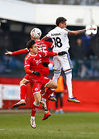 10th January 2021; Broadfield Stadium, Crawley, Sussex, England; English FA Cup Football, Crawley Town versus Leeds United; Tom Nichols and Archie Davies of Crawley and Raphinha contesting a  high ball from a goal kick